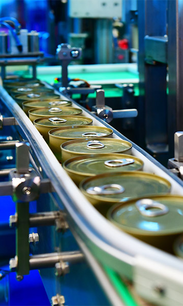 Cans of food on a production line.