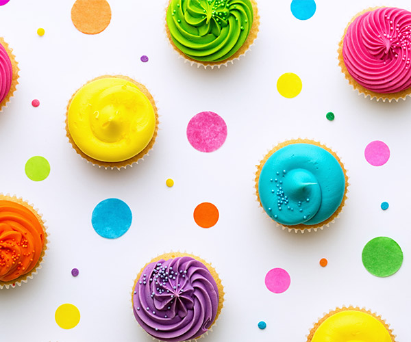 Cupcakes with brightly color icing.