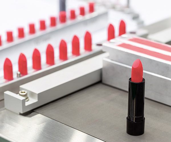 Pink lipstick on a production line.