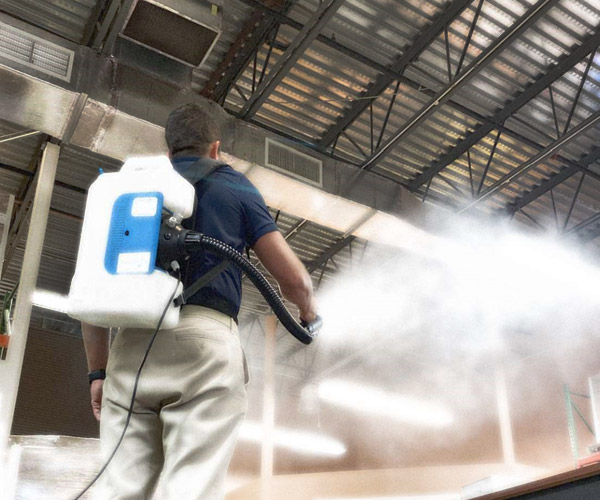 Technician applying PermaSafe through fogging.