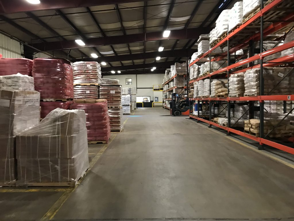 A forklift operator zips around Tilley Company's food and ingredient distribution operation at its Baltimore headquarters.