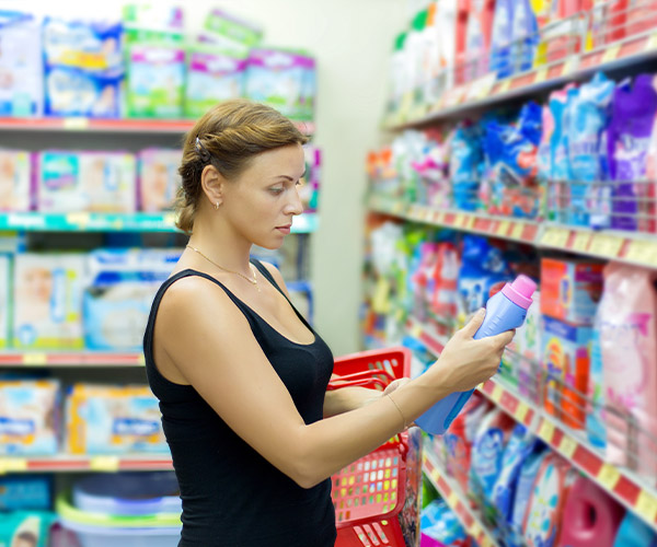 Woman selecting laundry care products